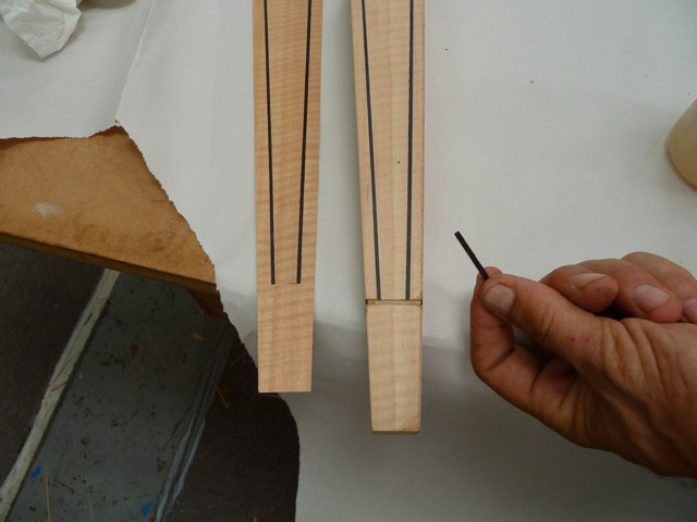 Route out and black veneer strip inlay