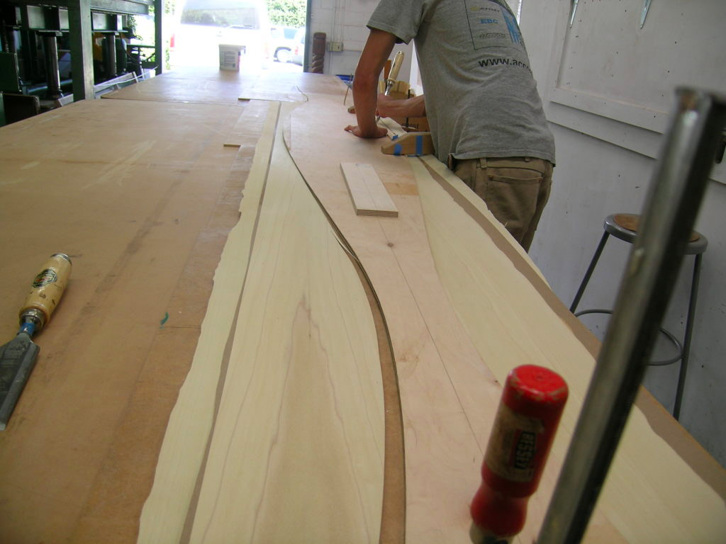Template cutting the 2-ply poplar veneer to size