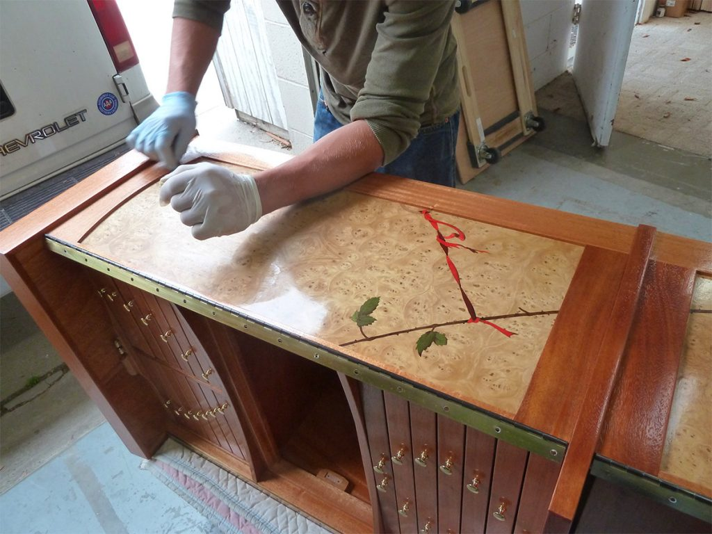 Oil / polyurethane is a great finish over veneer and solid wood