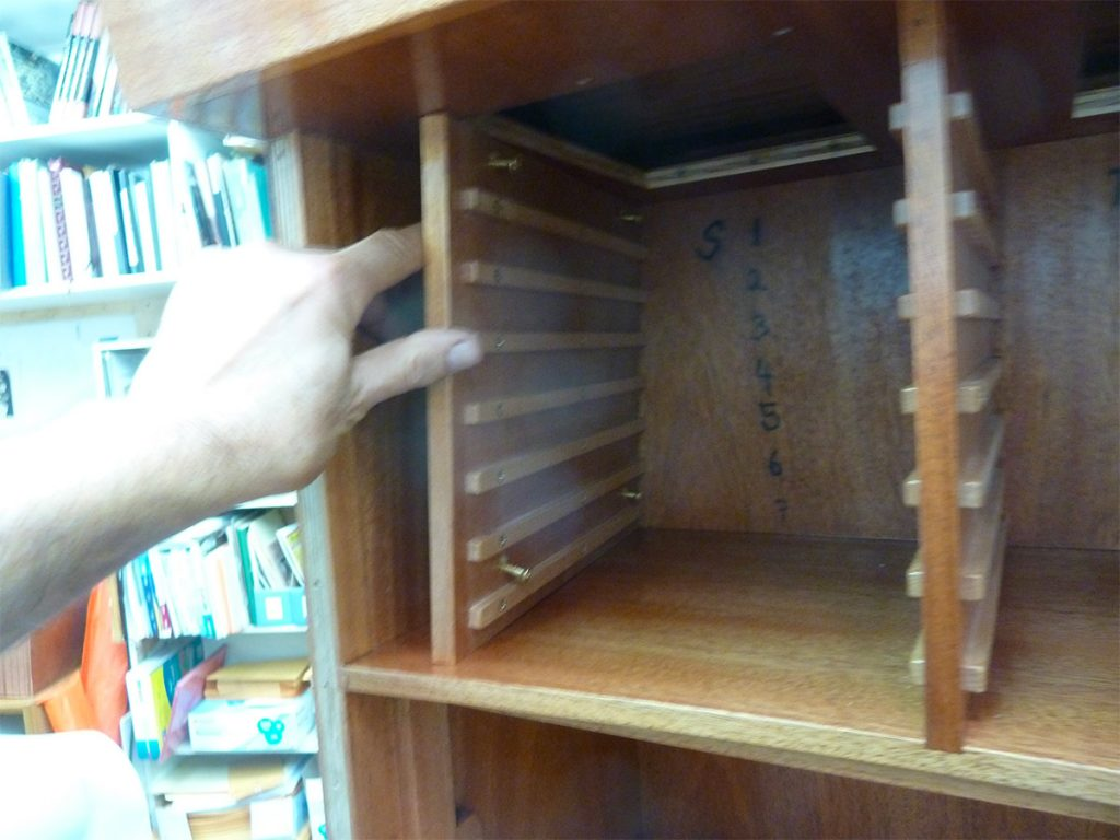 Setting dividers into place, and building the cabinet from the outside in