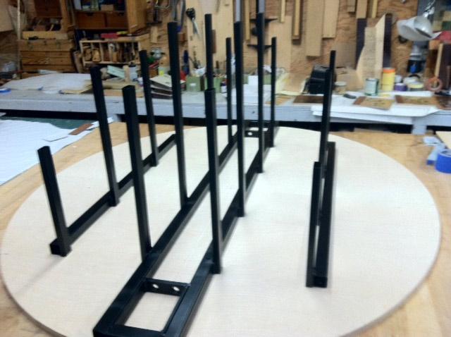 Custom welded steel shelf and pintel hinge support structure