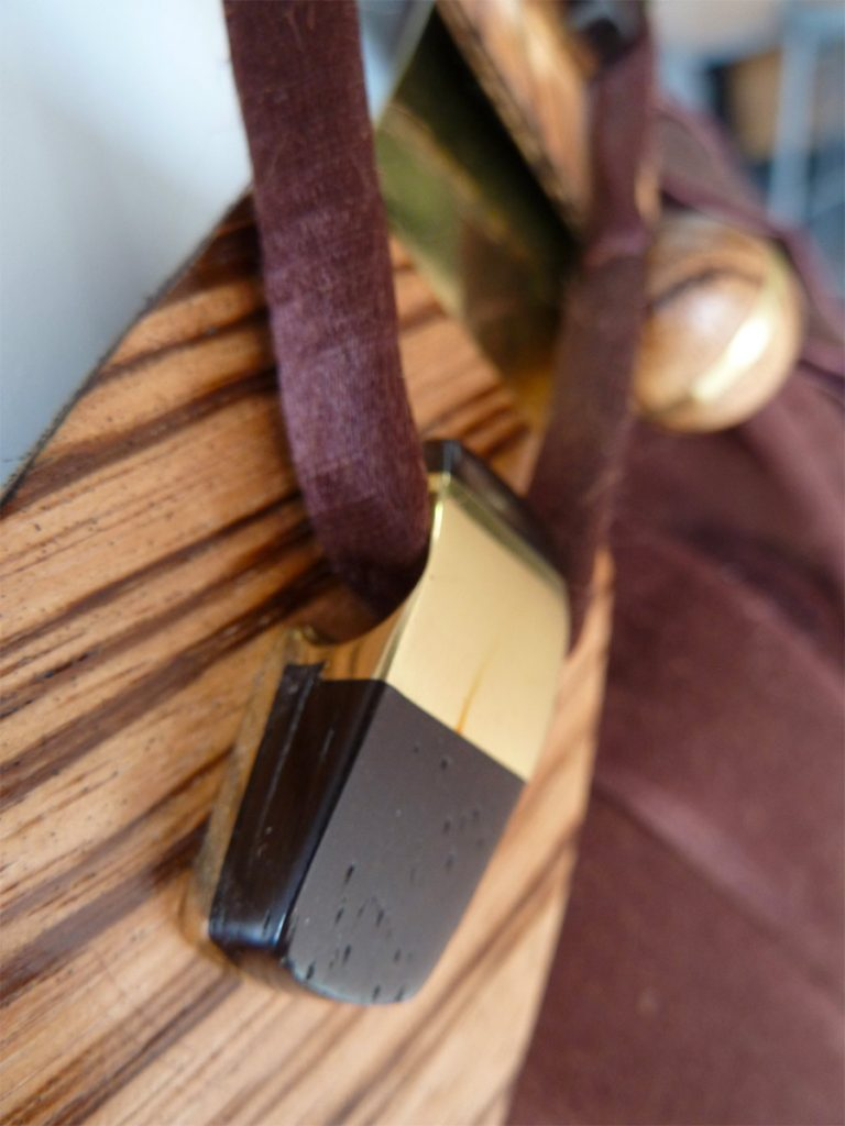 Closeup of the silk rope/harness fitting