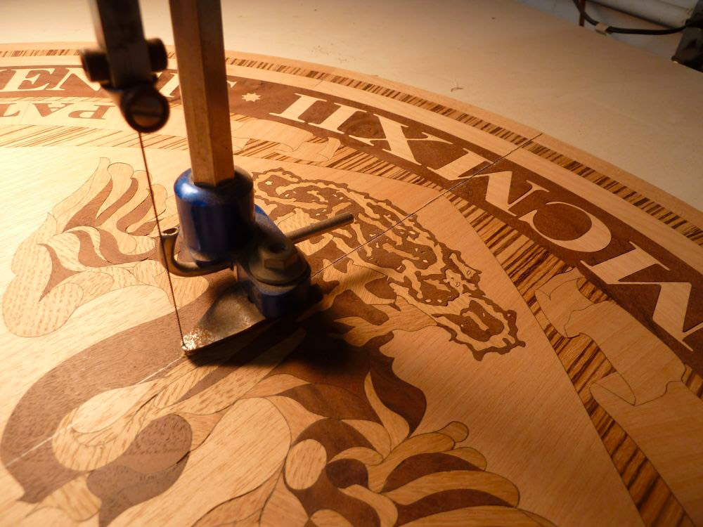 Cutting the marquetry plaque in half for the double door