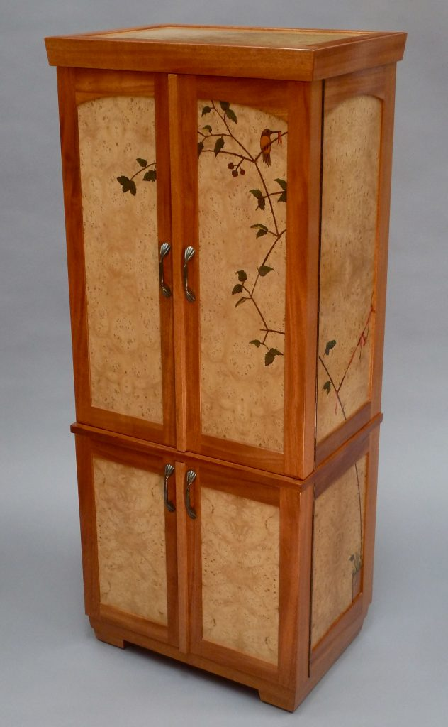 Hummingbird themed cabinet with functional jewelry storage